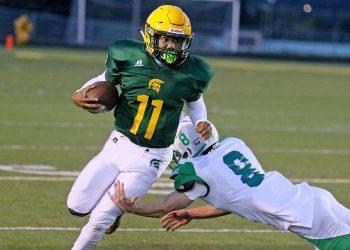 (Brad Davis/For LootPress) Greenbrier East quarterback Monquelle Davis gets past Robert C. Byrd defender Jaidan Willis Sept. 10 in Fairlea.