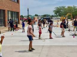 Kids learning tennis skills at LCCC/USTA Tennis Play Days