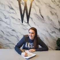 Sedona Wingeier signing her letter of intent
