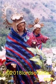 Marìa del Carmen, May 3rd, borne aloft in the Fair of Santa Elena de la Cruz, Tzununá, Santa Cruz la Laguna.