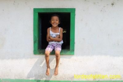 Girl seated in window in San Gabriel