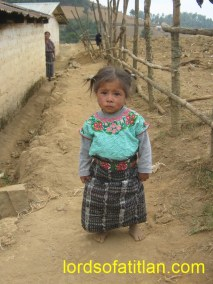 Little girl from Patzutzún bidding me farewell while Grandma looks on in the background.