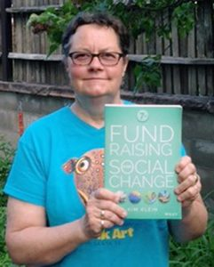 Kim Klein proudly displays the latest edition of her popular fund-raising book.