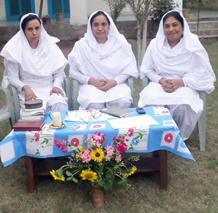 Evening Prayers - From left, Maria Daniel, Nasreen Daniel and Samina Iqbal begin their renewal of vows celebration with evening prayers in their garden. (Photo courtesy of Pakistan Sisters)