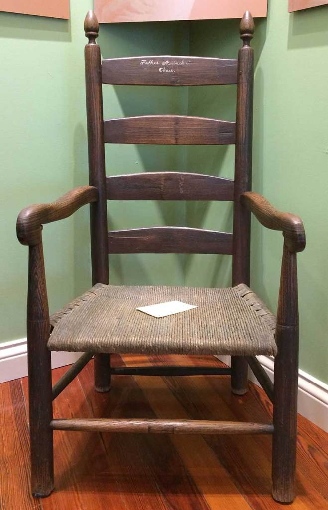 Oak chair with woven seat which belonged to Father Charles Nerinckx, founder of Loretto.