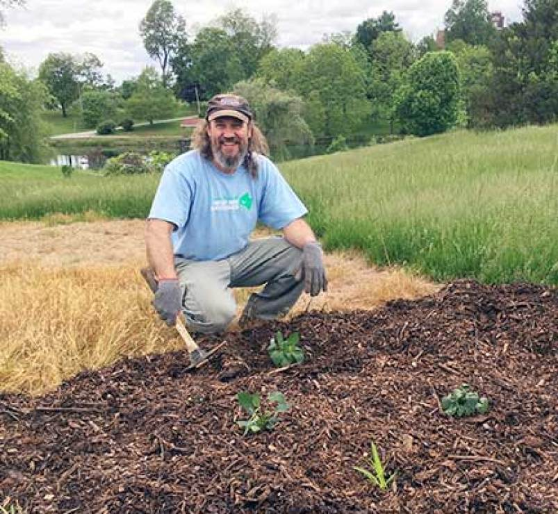 Gary Libby from Skybax Ecological Services helps to convert a portion of the Motherhouse lawn above Badin Pond to pollinator habitat.