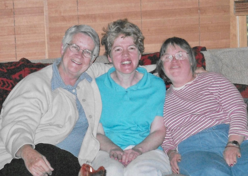 Mary Catherine Widger SL is pictured sitting with two Bridge Community residents.