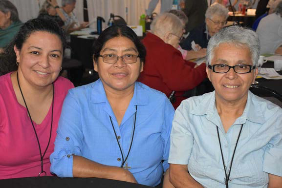 Three Loretto Co-members sit together