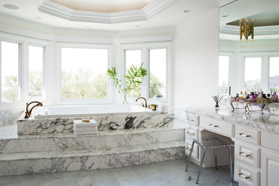 The master bathroom is actually one of my favorite rooms of the home. Because we liked the marble so much and because of the expense of replacing it we decided to leave the master shower in its original configuration and just replace the Faucets.