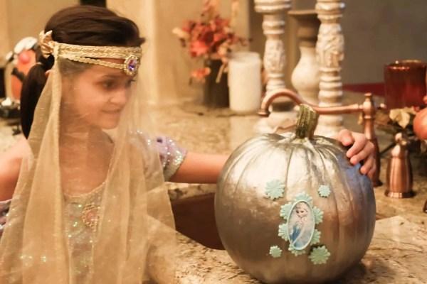 Princess Jasmine costume and Frozen Elsa designed pumpkin