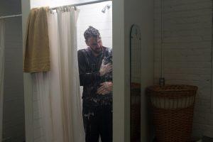 "Alejandro Álvarez Cadilla as Milton Frank, taking a shower in ""Off Kilter."""