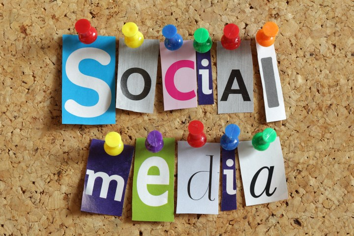 "Each letter in ""social media"" is cut from a different document and pinned to a bulletin board."