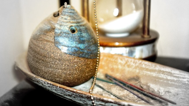 incense and hourglass