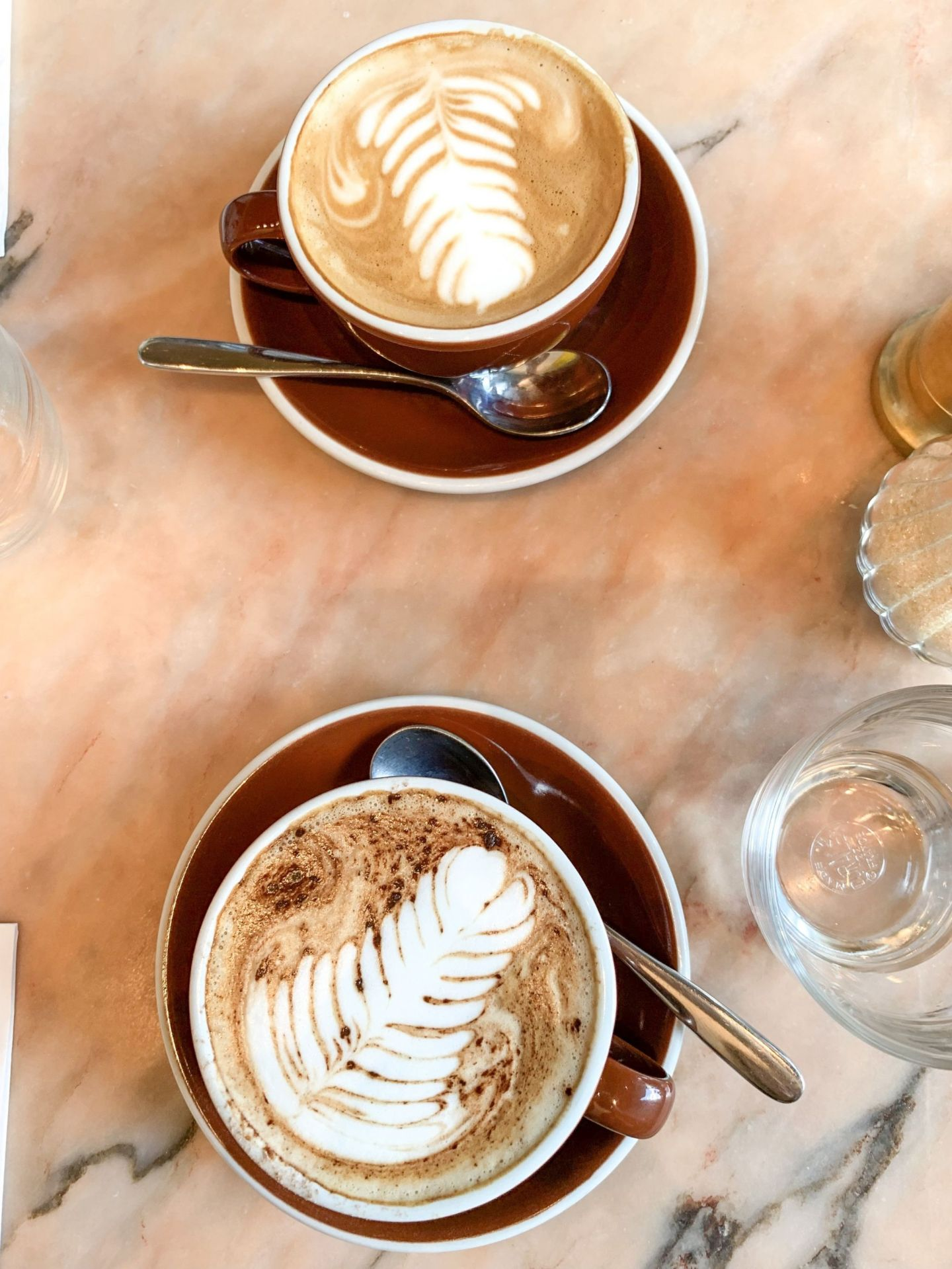 Cappuccino for me, flat white for him…