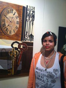 Mitzi Macias photo with artwork in background.