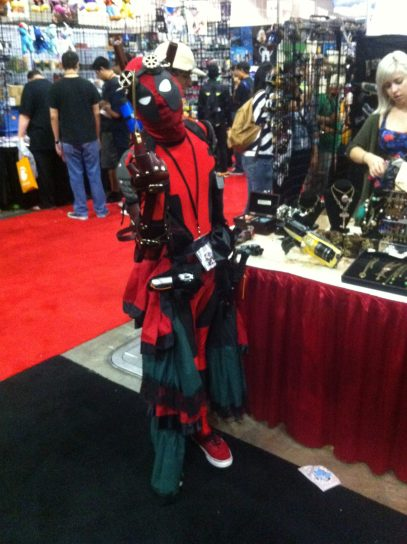 Caption: Deadpool Cosplayer poses for HMG-CN at Anime Expo 2014. Daniel E Beckham Photo.