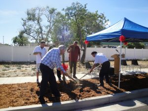 Bellflower Mayor Santa Ines and city council members prepare to finish the official tree planting over on Virginia Street on Wednesday.  Tammye McDuff Photo