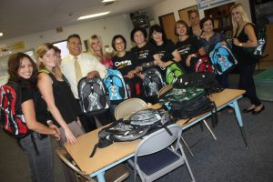 Volunteers gathered at the Willow Education Center on Thursday to help distribute hundreds of new backpacks for students in the ABCUSD.  The group includes Dina Alcantar, Irene So, Jill Wang, Reeza Gervacio, Pauline Kong, Niki Shah, Josie Troung with LBS Financial, Amanda Criscuolo from Broadview Mortgage, Rachel Holborn with Old Republic.  Also in the photo in the center is the groups co-chairman Mark Anthony Ruiz with Century Astro Relators.  Randy Economy Photo