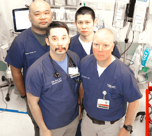 LIFE SAVERS: Front (l-r)  Kevin Menes, MD, James Walker, DO. Back (l-r) Patrick Flores, DO, Michael Tang, DO. The four work at Sunrise Hospital in Las Vegas, Sunrise was the closest hospital to the Las Vegas massacre site. Photo courtesy of Kevin Menes.