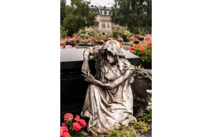 Statue of a kneeling girl as a cemetery adornment in Nuremburg Germany