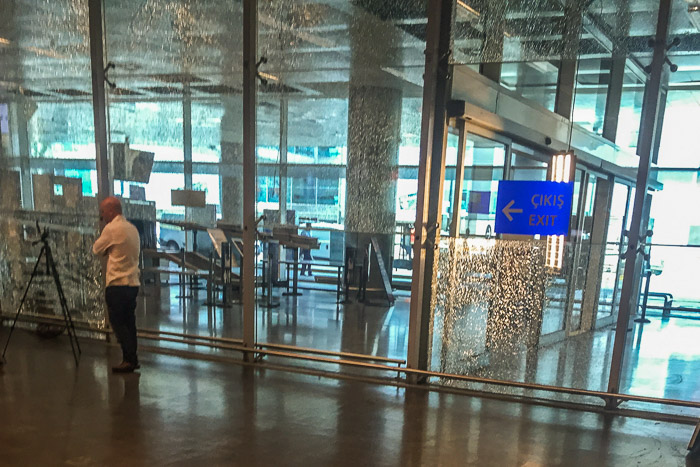 Cracked glass in arrivals from bullets at the Ataturk Airport | Lost Not Found | Attack on Istanbul's Ataturk Airport