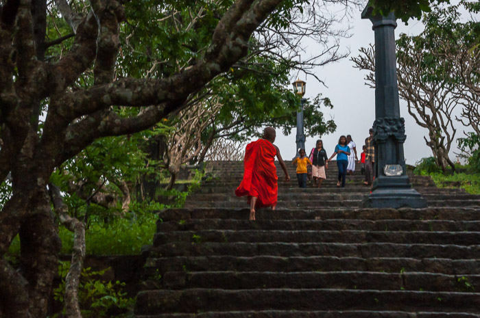 A young monk running up the stairs at the Dambulla Cave Temple in Sri Lanka | LOST NOT FOUND | Thoughts & Feelings Sri Lanka