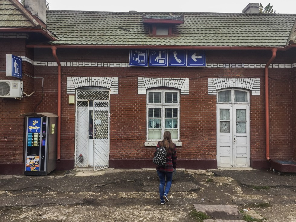 Girl at train station platform in Romania | LOST NOT FOUND | Europe Travel | Travel Stories| Travel by Train | Romania | Bulgaria | #Bucharest #Sofia #TrainTrip