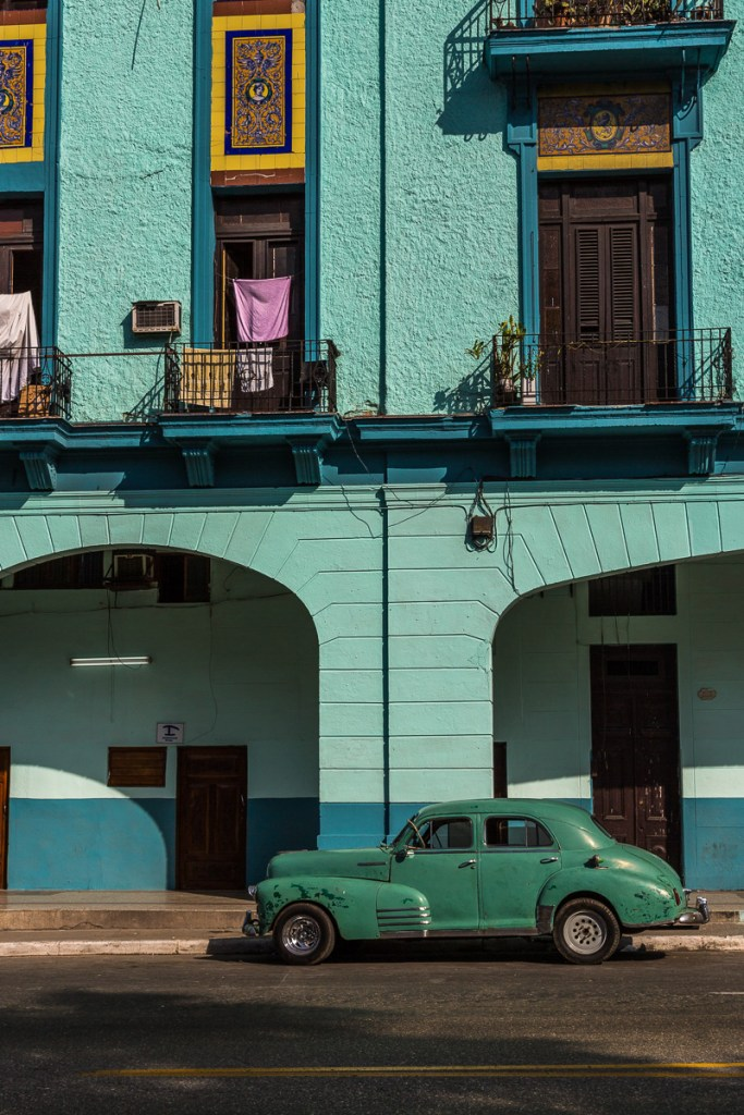 A green old American car in front of a turquoise building in Havana Cuba | LOST NOT FOUND| La Habana | Cuba | Havana | Street Photography