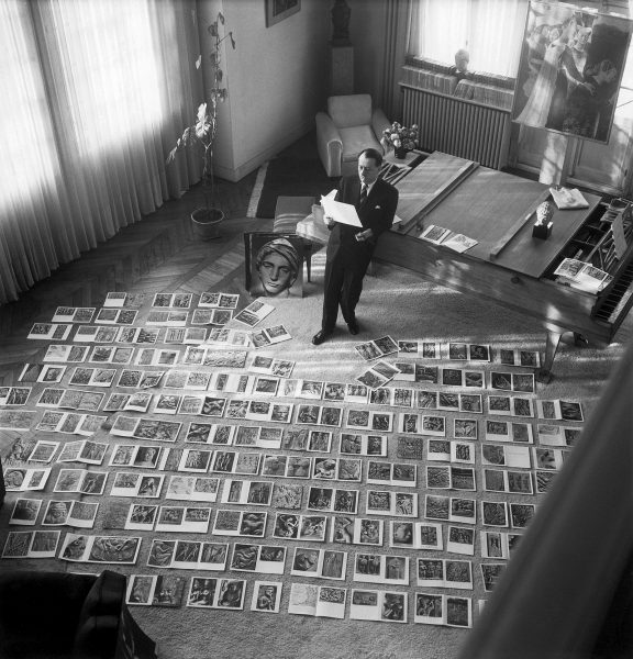 1952 - André Malraux in the process of selecting images for the book Le musée imaginaire de la sculpture mondiale
