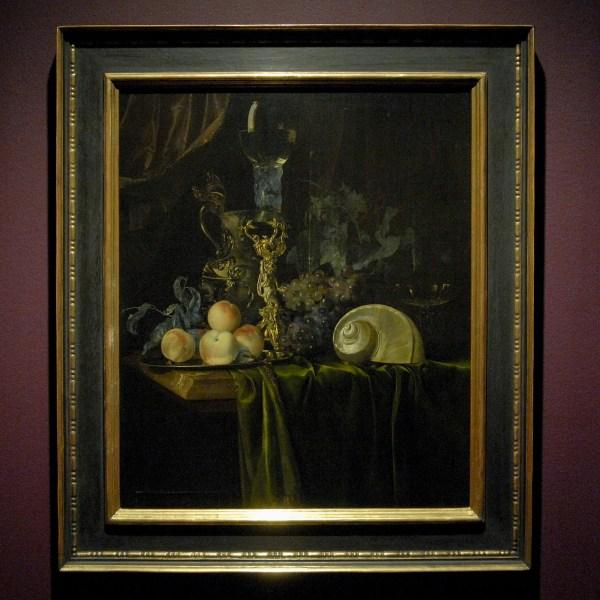 Willem van Aelst (?) - Stilleven met siervaatwerk, nautisschelp en vruchten op een donker kleed - Olieverf op doek, 1659