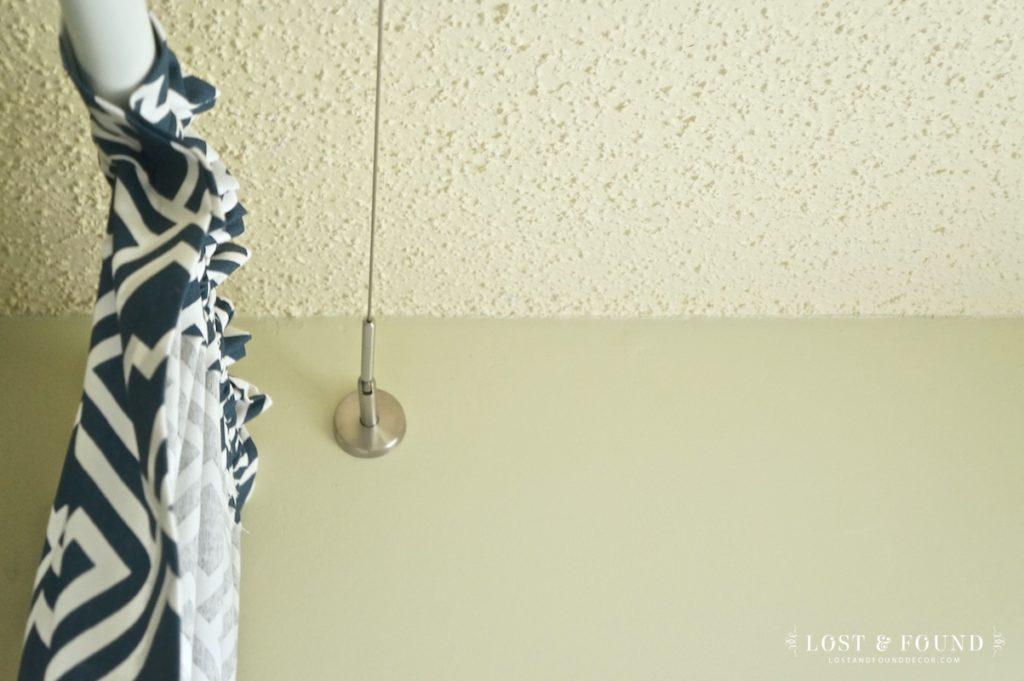 Shower curtain hidden behind fixed curtain panels