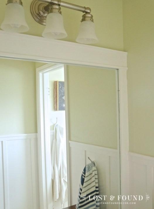 wood trim installed around builder grade bathroom mirror