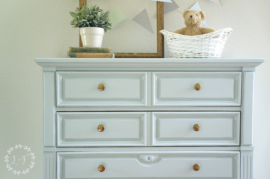 painted blue chest for baby nursery