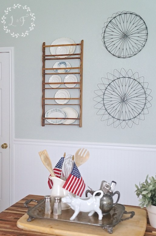 Kitchen Decor, using old parts of metal, folding laundry basket as wall art