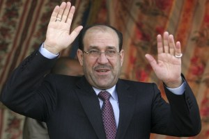 Iraq's Prime Minister Nuri al-Maliki waves to supporters during a political rally in Kerbala