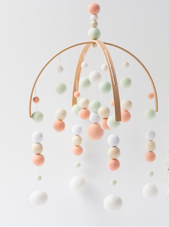 Modern Crib Mobile Nursery Decor In Peach And Mint For A Chic Baby Girls Nursery