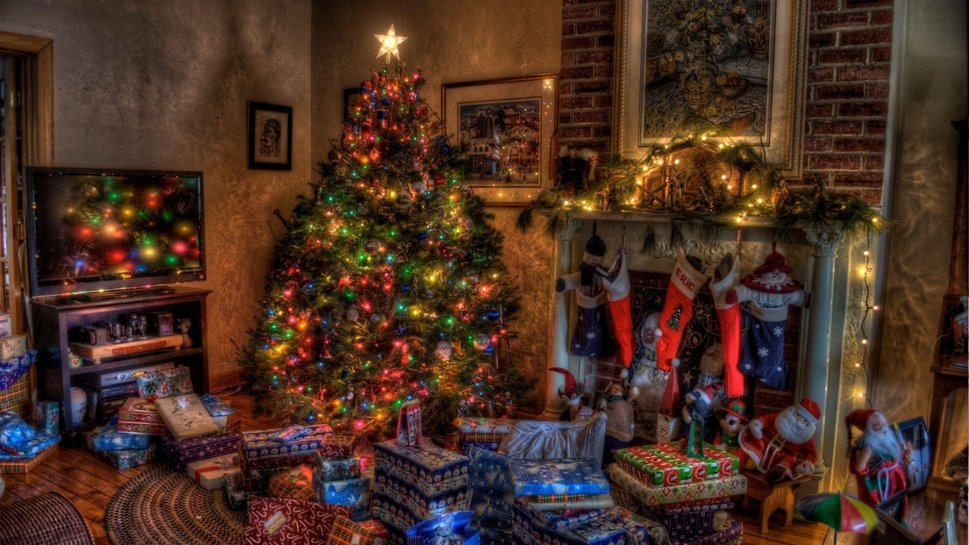 648097christmas_comfort_stockings_holiday_presents_tree_fireplace_background_wallpaper_imagep