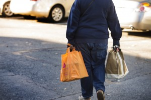 UNITED STATES - November 23, 2015: A person carries bags packed with food from Interfaith Relief in time for Thanksgiving. (Photo By Douglas Graham/Loudoun Now)