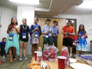 The officers distribute superlatives at the last fellowship.
