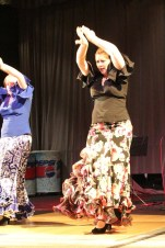 Flamenco dancers ignite an energetic crowd.