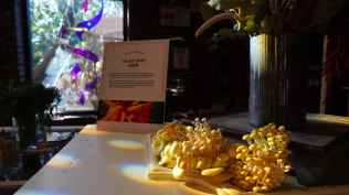 Mushrooms adorn the counter. Assorted fresh vegetables served as decor all over the room.