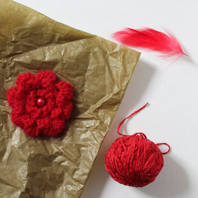 gift-wrap-coordinating-with-gift-using-feather