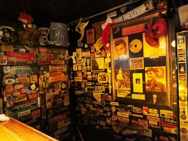 band-stickers-behind-bar-the-horseshoe