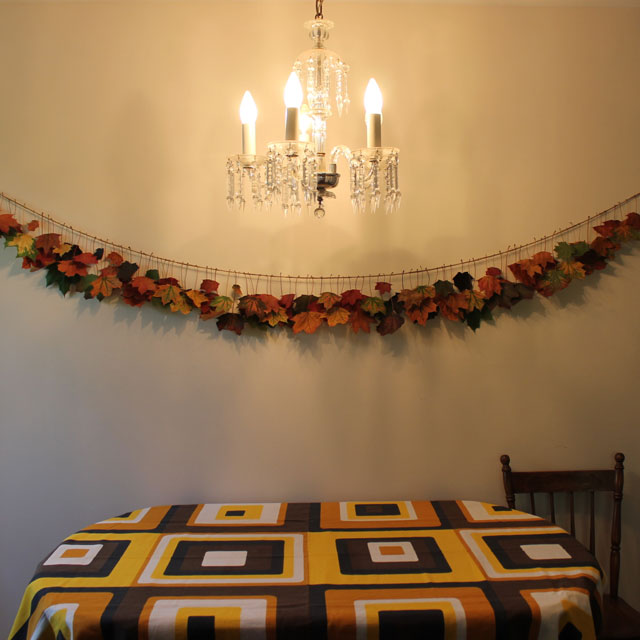 handmade-garland-with-colored-fall-maple-leaves-and-twine-diy