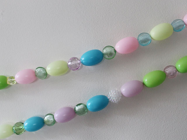 close-up-of-handmade-easter-decoration-garland-with-beads-and-eggs