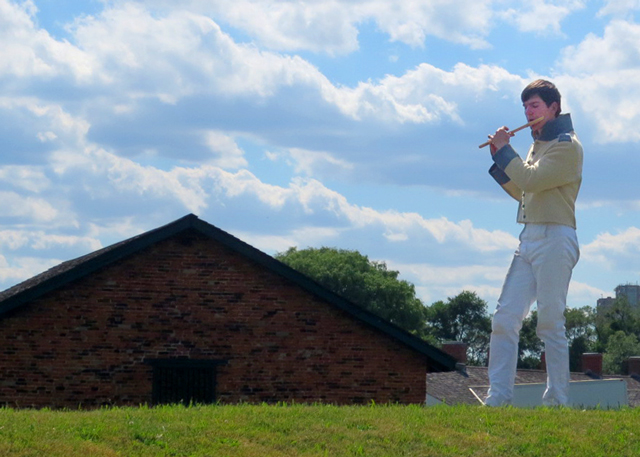 boy-playing-fife-wearing-historic-uniform-fort-york-toronto