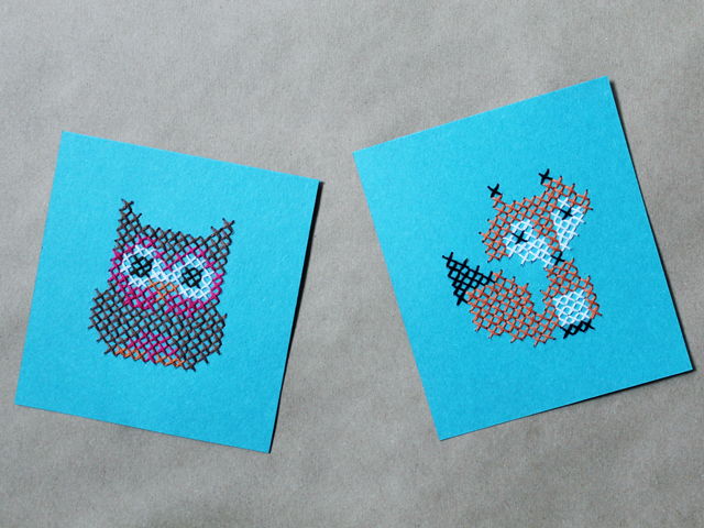 simple-patterns-cross-stitched-onto-paper-fox-and-owl