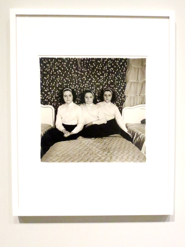 diane-arbus-photograph-triplets-in-their-bedroom-on-display-at-ago-toronto-outsiders-exhibit