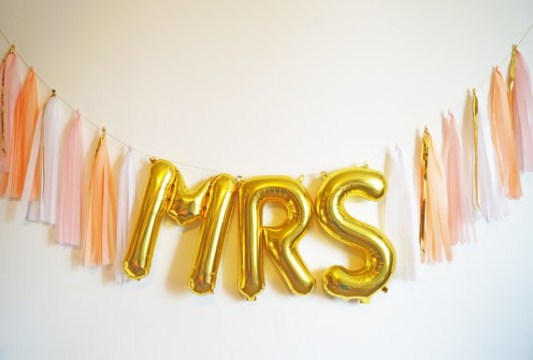 21 Jumbo Ideas for Gold Letter Balloons at Your Wedding Gold foil balloons spelling out MRS with pink  white and peach tassels by  Steph Shives