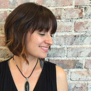 Medium-short A-line bob with fringe and highlighted tips